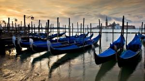 Picturesque Venice - paint gondolas by the harbour