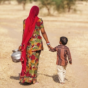 """Indian woman carrying water from the well, Rajasthan"""