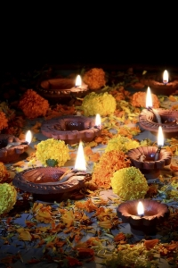 Clay diya lamps lit with Lord Ganesha during diwali celebration