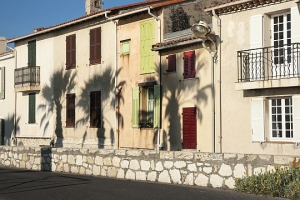 shadows of palm trees on walls in Antibes.